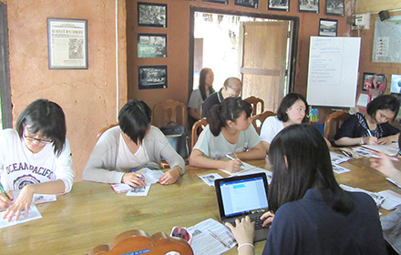 Students carrying out interviews at a Thai NGO